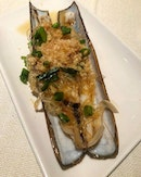Scottish razor clams with garlic and mung bean noodles.
