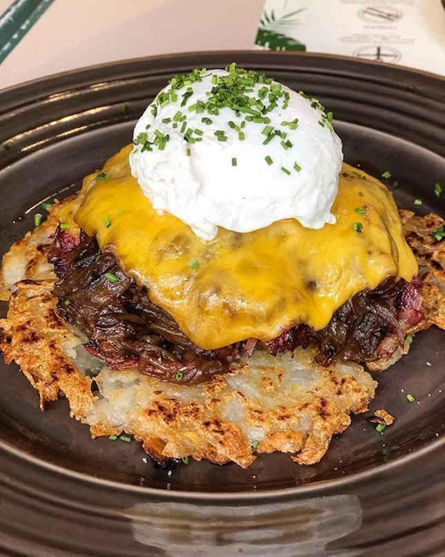 Salt beef hash, served with lots of caramelised onions and a poached egg on a bed of rosti