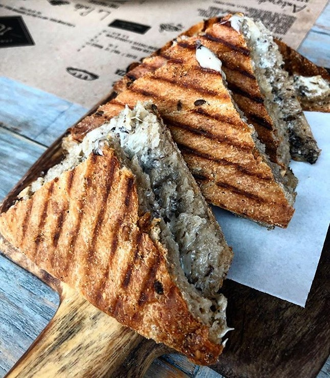 Stuffed Schiacciata ($10; small)  Oozing with creamy cheese and bits of black mushroom, this heavenly dish is the ultimate comfort food.