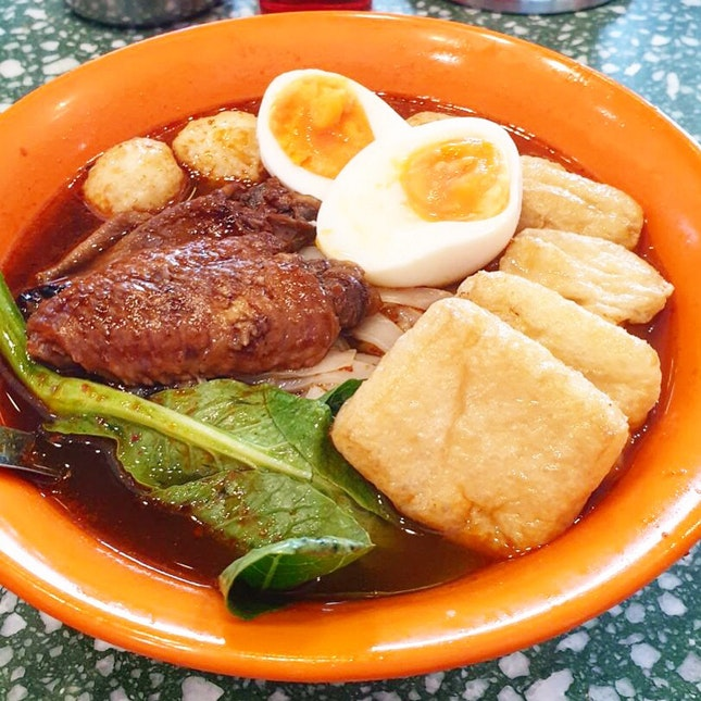 Yuan Long boy ($11.80++) Spicy curry noodle with soft boiled egg, braised chicken wing, curry fishball, beancurd puff.