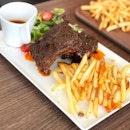 Mala rib-ous ($18.90++) Pork ribs with a mala rub, served with fries and a salad.