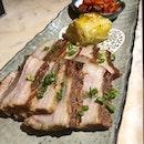 Joo bossam ($26)  Braised pork belly, spicy radish salad, white Yucha kimchi.