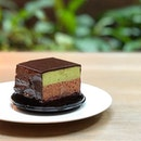 Matcha chocolate mousse cake with a brownie base.