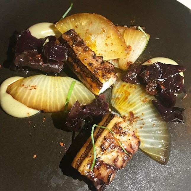 Grilled Spanish octopus with Jerusalem artichoke, burnt onion and oyster leaf.