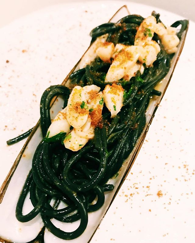 Squid ink tonnarelli with Scottish bamboo clams, topped with bottarga (salted and cured fish roe).