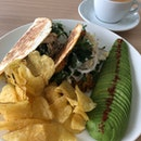 Curried Chicken Wrap ($13.90) Add On Avocado ($4.50); Flat White ($5.50)