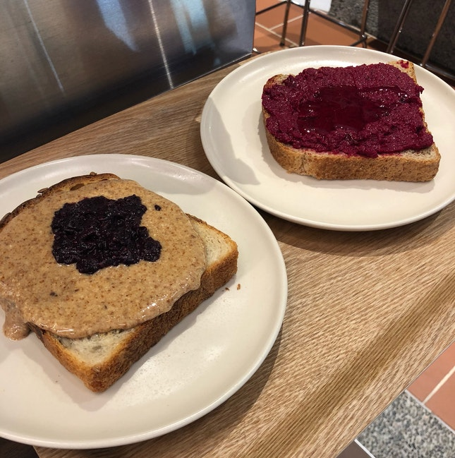 Almond Butter And Blueberry + Pumpkin Seed Sourdough ($7.50+), Beetroot Hummus + Wholegrain ($6+)