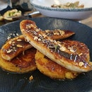 Polenta pancakes and caramelized bananas with lavender maple sauce.