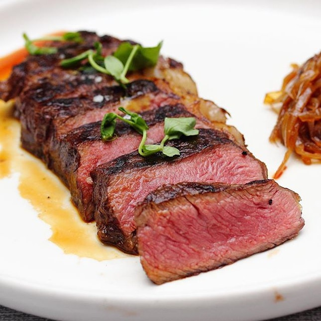 [Mo'mor Izakaya] - The Black Angus Ribeye ($38) is dressed in a natural jus and paired with onion confit.
