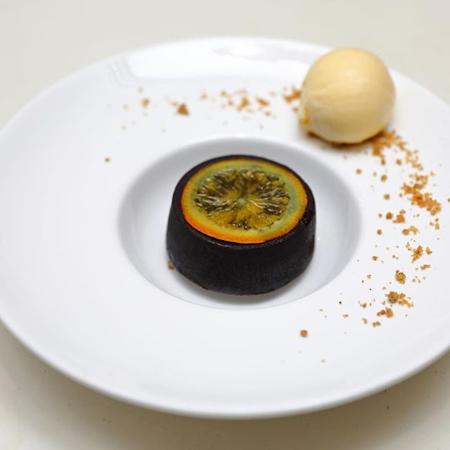 [Antoinette] - The Fondant au Chocolat ($14) is a warm chocolate cake, served with cold brewed coffee ice cream and  orange confit.