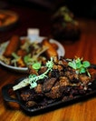 [Birds of A Feather] - the Charcoal Grilled Pork Bits ($15) is super addictive.