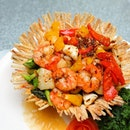 [Park Hotel Clarke Quay] - Served in an edible yam basket is the Stir Fried XO Seafood.