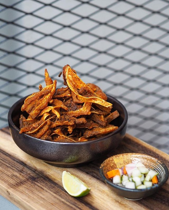 [Fat Chap] - The Crispy Pig's Ear ($12) is a crispy fried snack, coated with a special homemade curry powder mix.