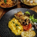 [Farmers & Chefs] - For just $10, The Farmer's Breakfast comes with a hearty portion of sous vide herbed boneless chicken thigh slices (no cured meats!), alongside scrambled eggs, grilled Roma tomatoes, sauteed button mushrooms and crisp Rosti with a dollop of Farmer's Soy Mayonnaise.