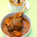 [COMO Cuisine] - Lamb Shank Massaman ($45++) served with naan bread and lightly pickled pineapple and cucumber.