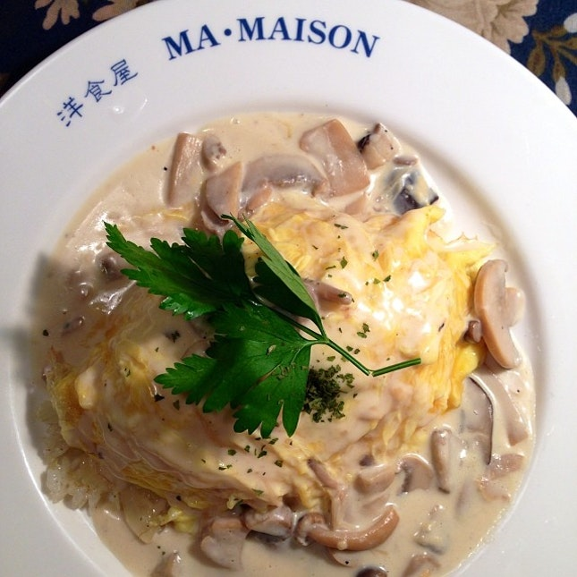 Omu rice with mushroom cream sauce.