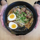 A bowl of hot ramen with meaty companions and comforting egg is always a rainy day saviour.