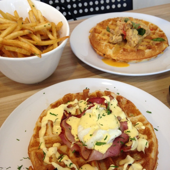 Clockwise from top left: Truffle fries (SGD9), Salted egg chicken waffle (SGD12), & Poached egg bacon waffle (SGD10)