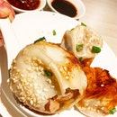 生煎包, Signature Pan-Fried Crispy Pork Soup Buns ($5/4 Pieces).