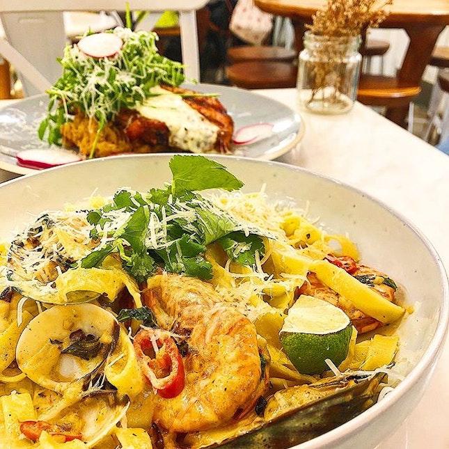 Tomyum seafood pasta ($16), Pork chop and sweet potato mash ($19).