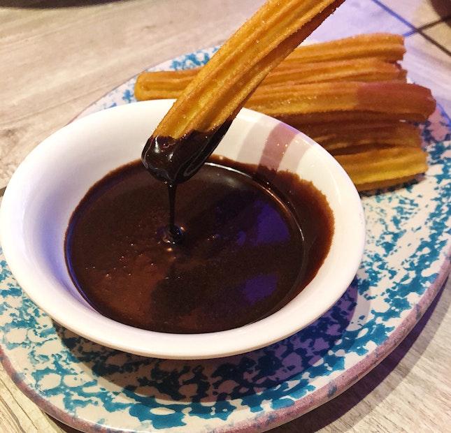 Churros Con Chocolate ($9).