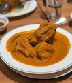 Chicken curry...tender meat that fall off the bones just with a slight pry, and packed with fragrant spices.
