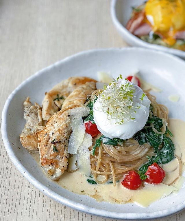 Everything I love about a pasta dish...blistered tomatoes, wilted spinach, poached egg + grilled chicken.