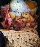 Morning fuel of potato hash with corned beef, poached egg, strips of bacon and toasted ciabatta.
