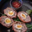 Some scotch eggs, some crispy duck, some pork knuckle.