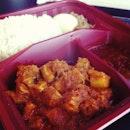 Nasi lemak with pork rendang.